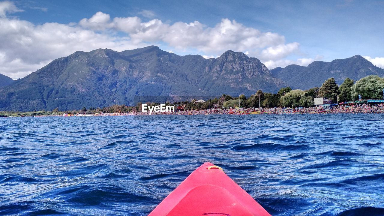 water, mountain, sky, cloud - sky, beauty in nature, nautical vessel, transportation, scenics - nature, nature, sea, mountain range, day, waterfront, mode of transportation, no people, outdoors, idyllic, tranquil scene, tranquility, floating on water, mountain peak, inflatable