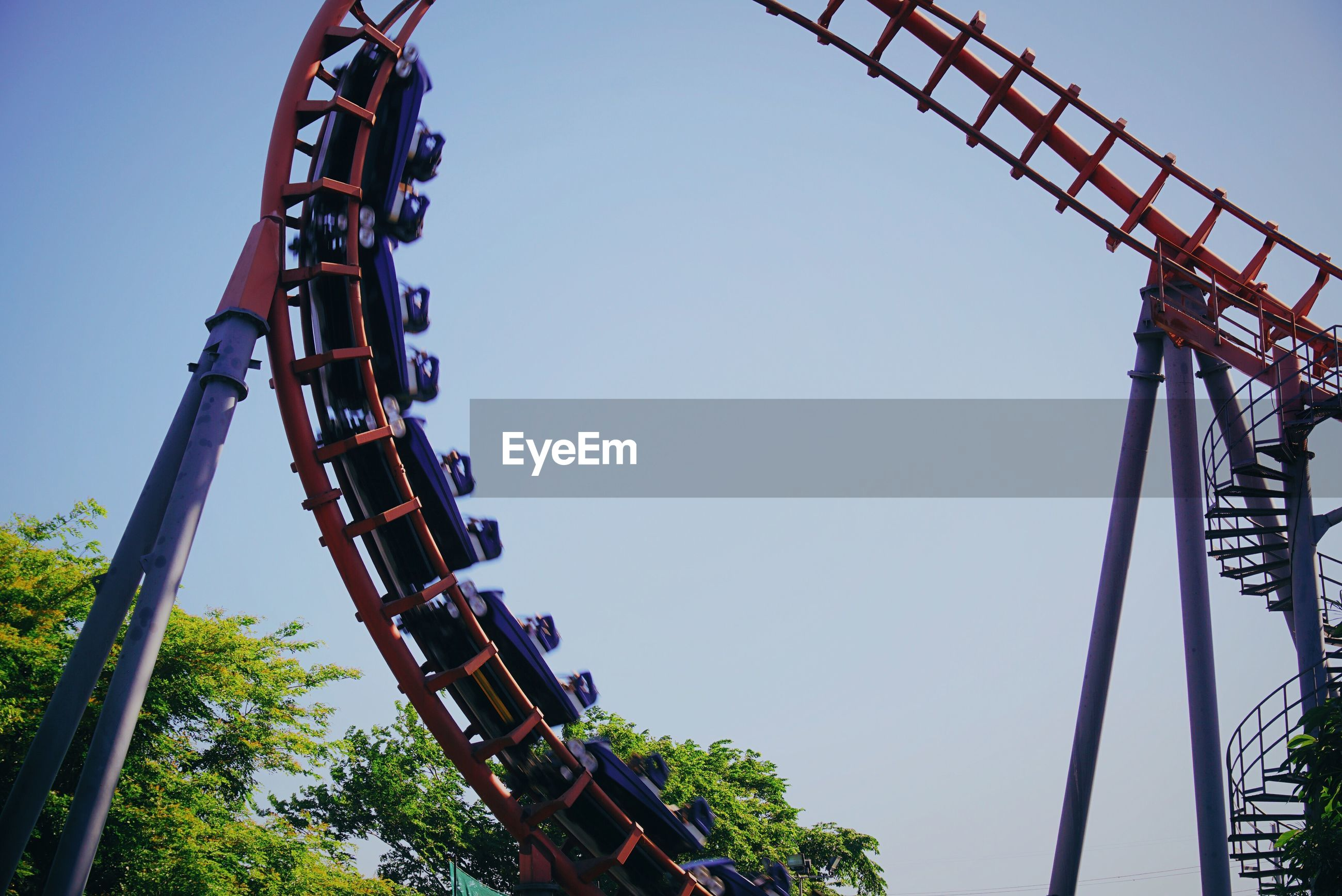 Low angle view of rollercoaster in action
