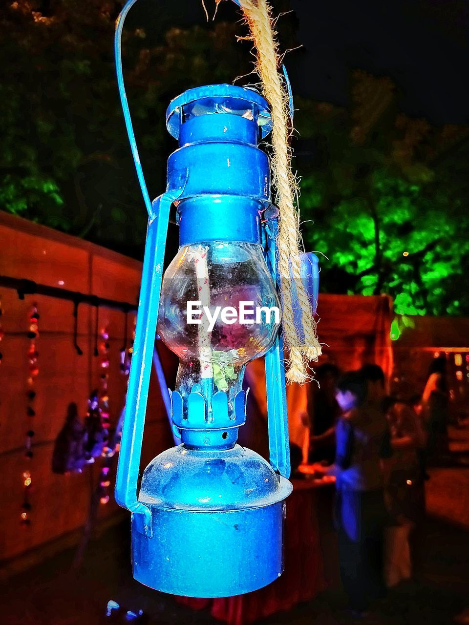 blue, focus on foreground, hanging, no people, night, outdoors, close-up
