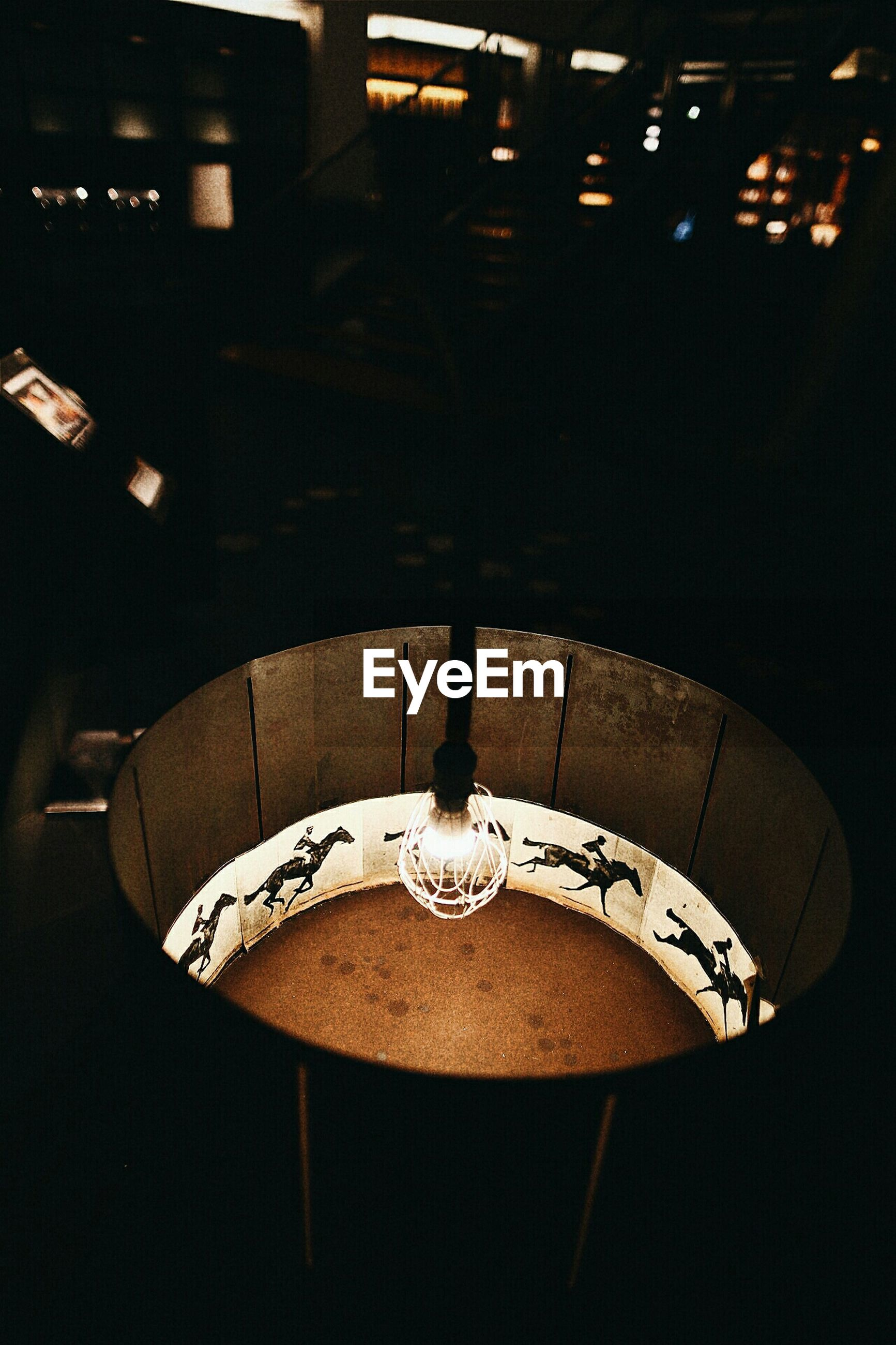 indoors, illuminated, lighting equipment, technology, electricity, close-up, electric light, night, no people, glowing, communication, table, light - natural phenomenon, electric lamp, light bulb, lit, high angle view, circle, dark, ceiling