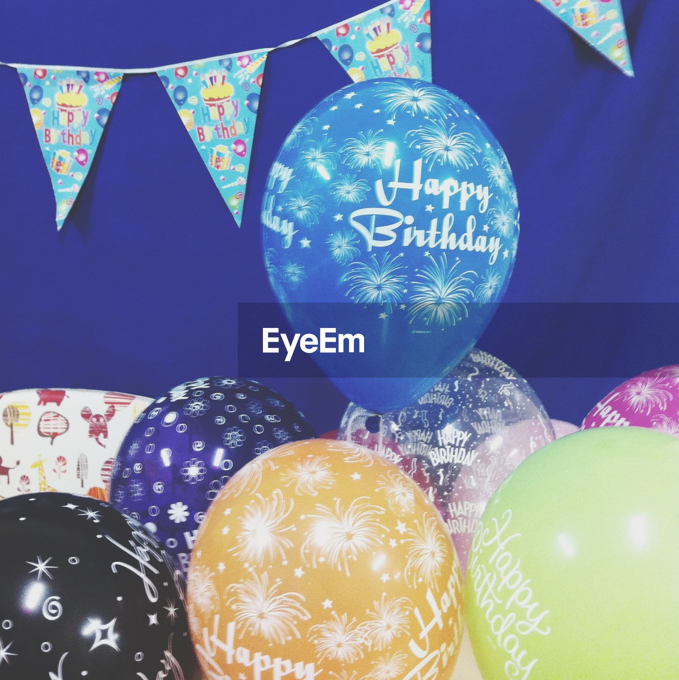indoors, close-up, text, communication, western script, sphere, multi colored, still life, circle, abundance, decoration, full frame, variation, no people, number, glass - material, large group of objects, geometric shape, celebration, pattern