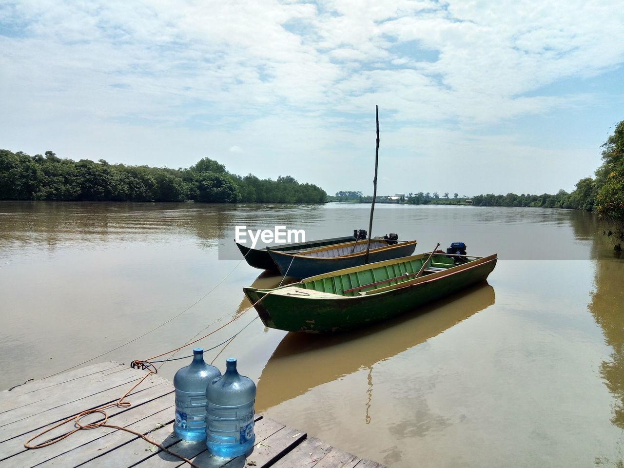 nautical vessel, transportation, water, mode of transportation, moored, lake, reflection, tranquility, sky, cloud - sky, nature, tree, day, tranquil scene, scenics - nature, plant, no people, beauty in nature, outdoors, rowboat