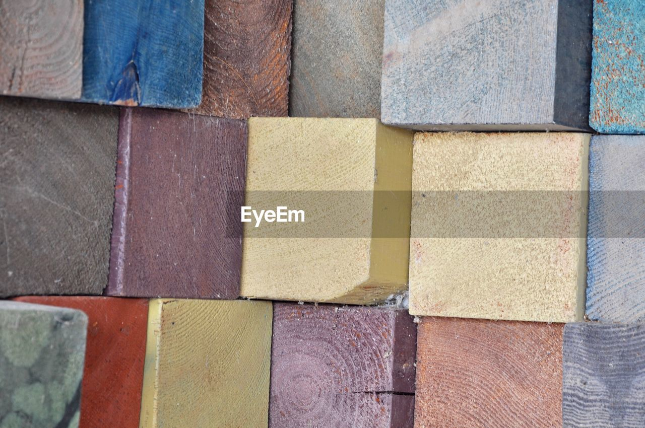full frame, backgrounds, multi colored, close-up, no people, day, variation, choice, side by side, in a row, block, pattern, large group of objects, order, arrangement, block shape, shape, textured, art and craft, wood - material, concrete