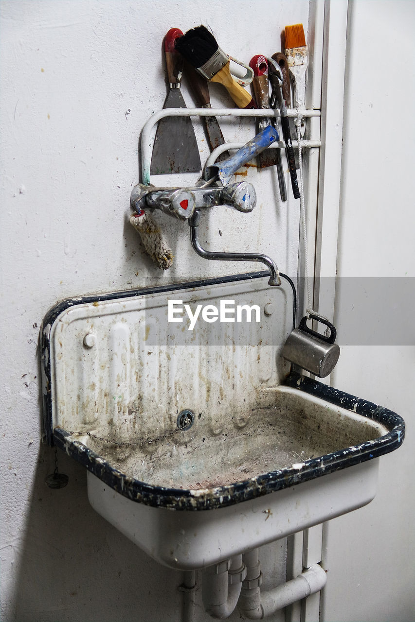 High Angle View Of Messy Sink On Wall