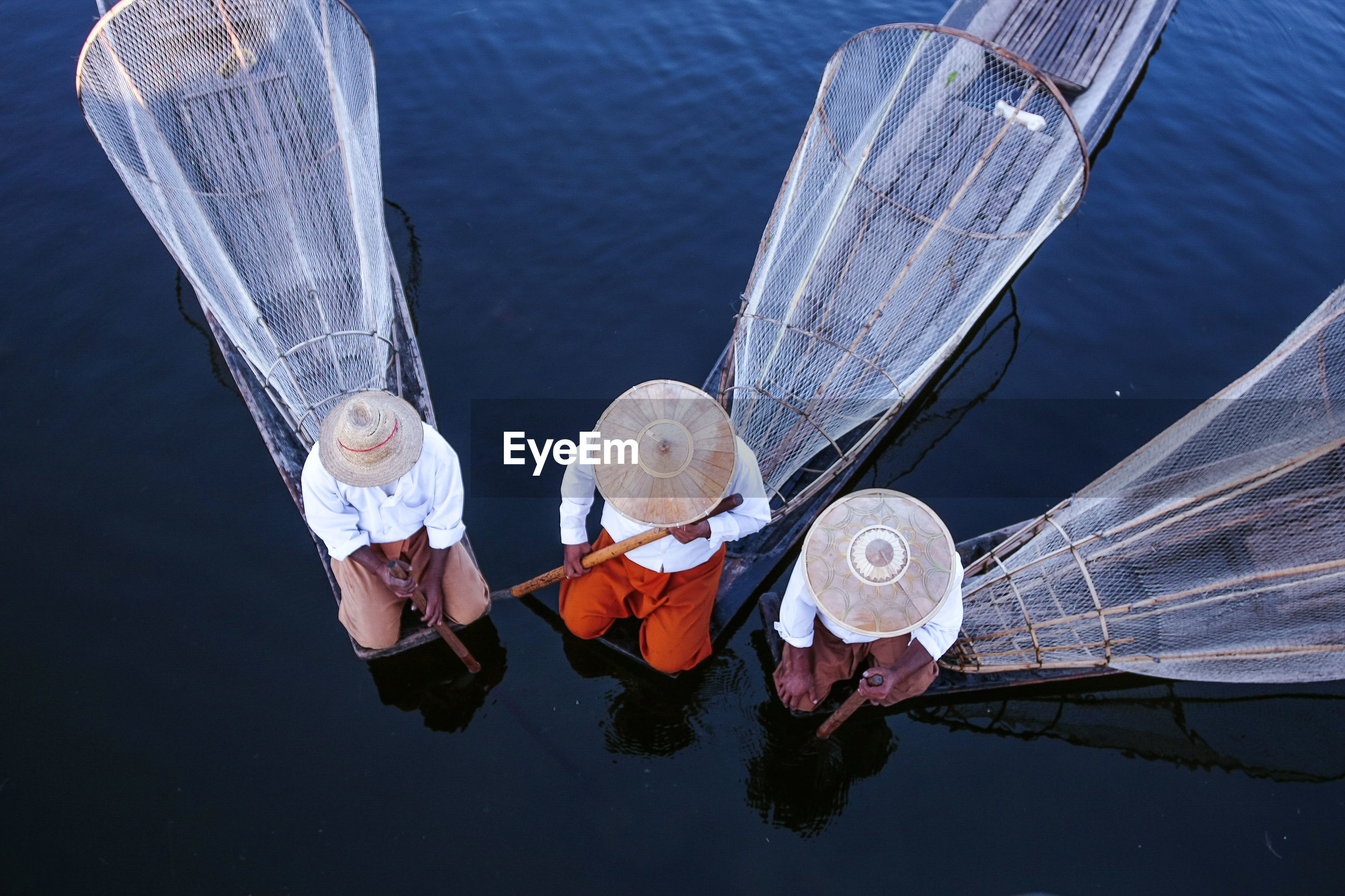 High angle view of fishermen in lake