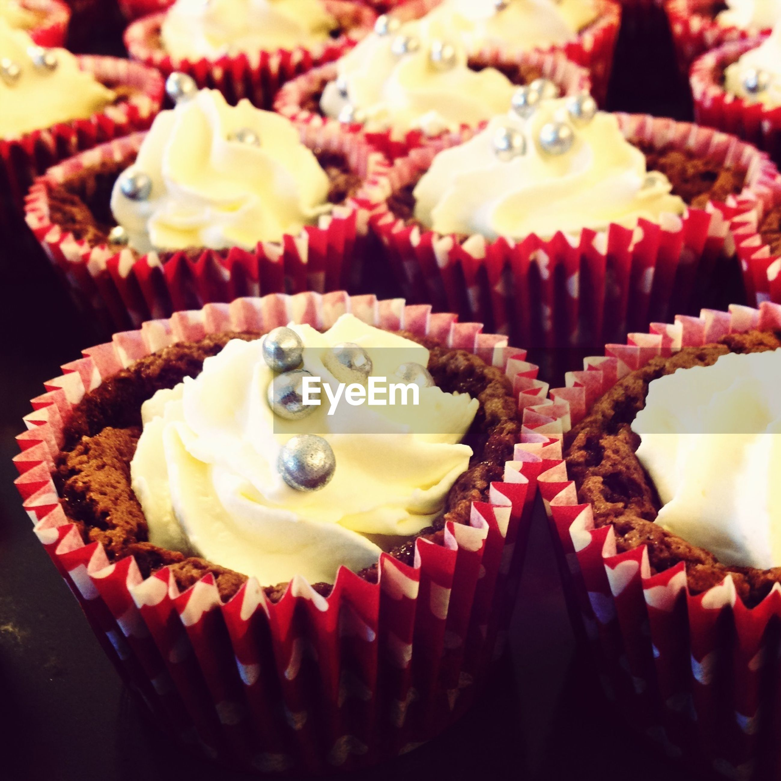 indoors, sweet food, freshness, dessert, still life, food and drink, cake, indulgence, food, ready-to-eat, rose - flower, close-up, unhealthy eating, high angle view, temptation, table, plate, flower, cupcake, chocolate