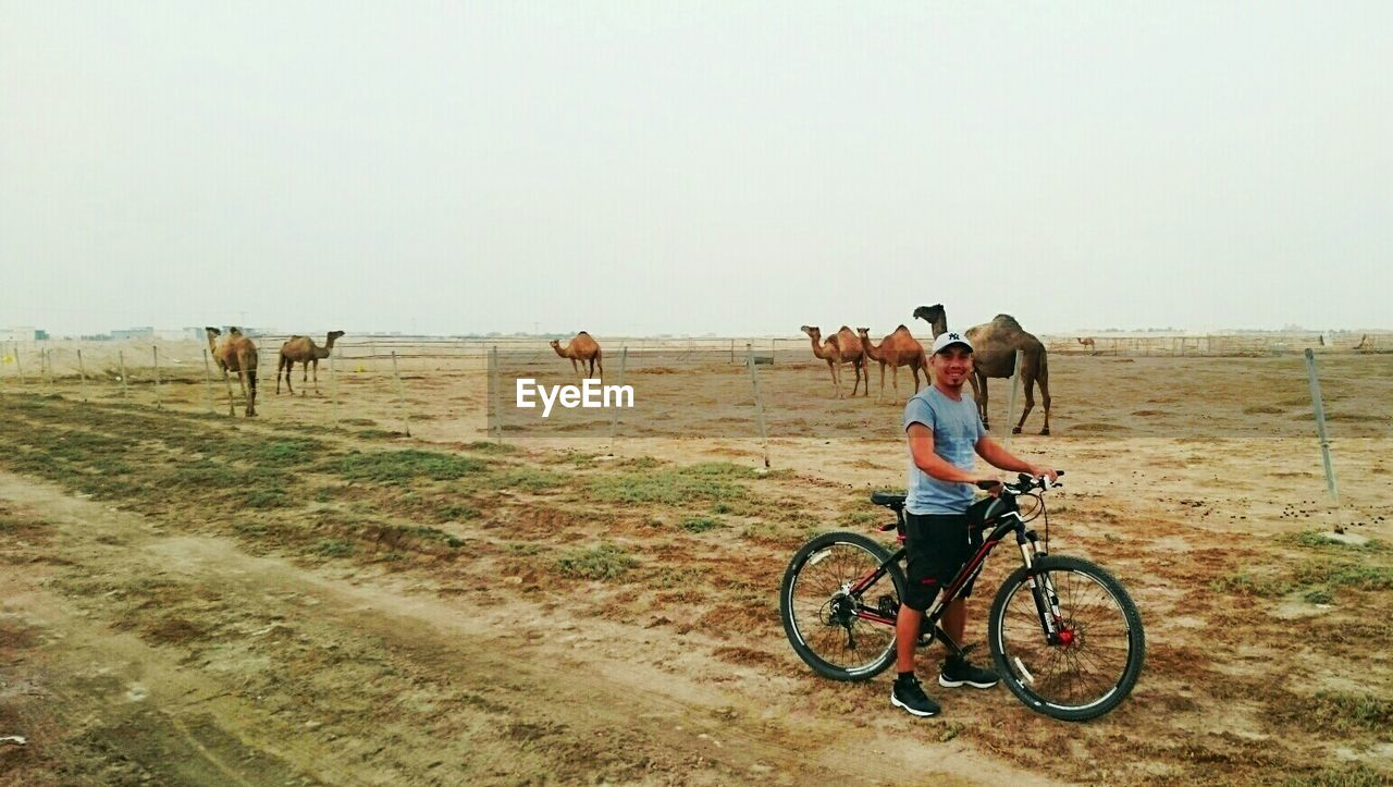 bicycle, real people, full length, transportation, day, riding, nature, men, outdoors, leisure activity, togetherness, landscape, clear sky, mammal, sky, people