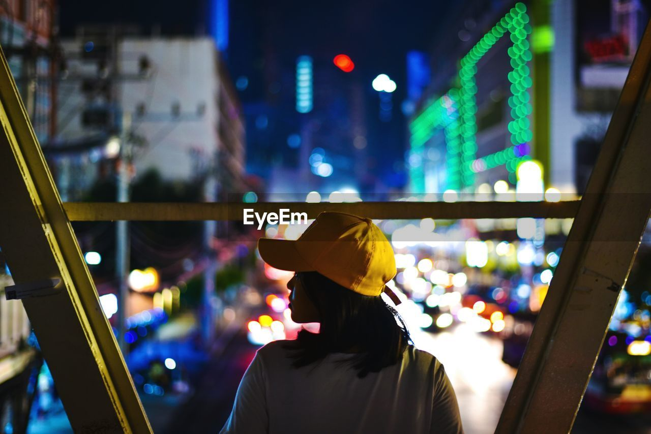 Rear View Of Woman In City At Night