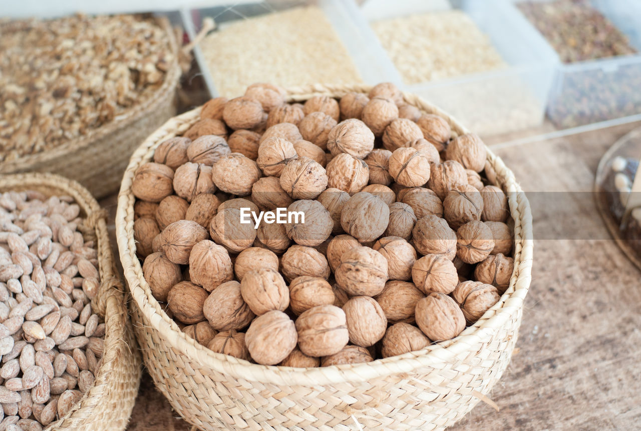 High angle view of fresh walnuts and almonds at market stall