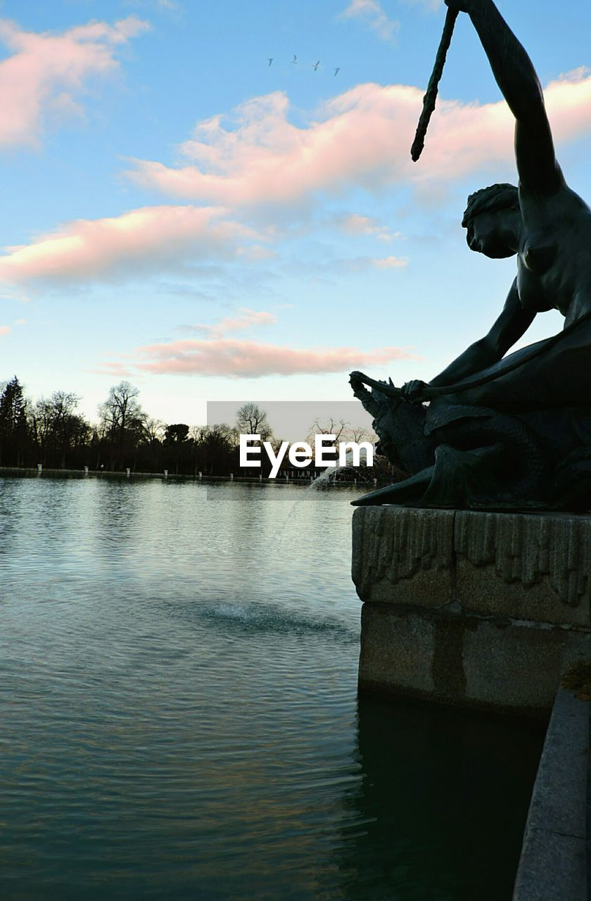 water, lake, sky, cloud - sky, outdoors, nature, sunset, day, sculpture, statue, no people, beauty in nature, nautical vessel, close-up