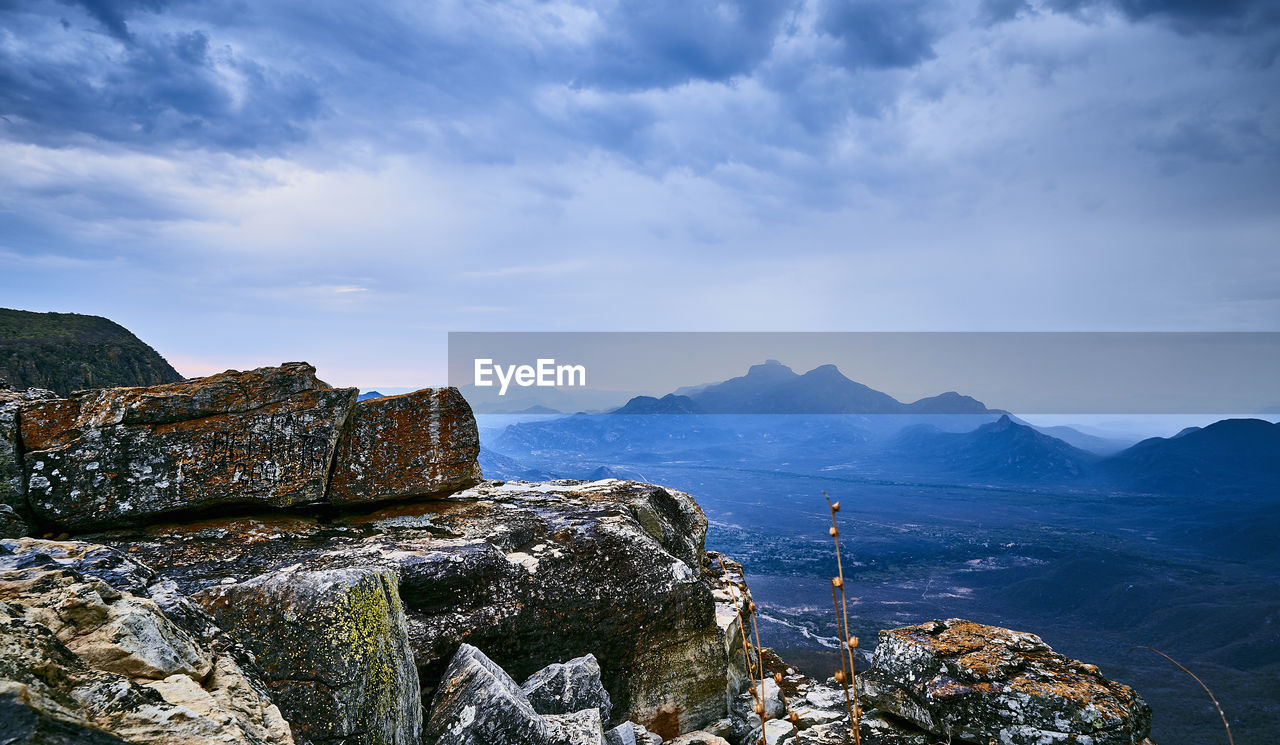 sky, mountain, cloud - sky, rock, scenics - nature, beauty in nature, rock - object, solid, nature, tranquility, sea, mountain range, tranquil scene, water, day, non-urban scene, no people, rock formation, idyllic, outdoors, formation, mountain peak