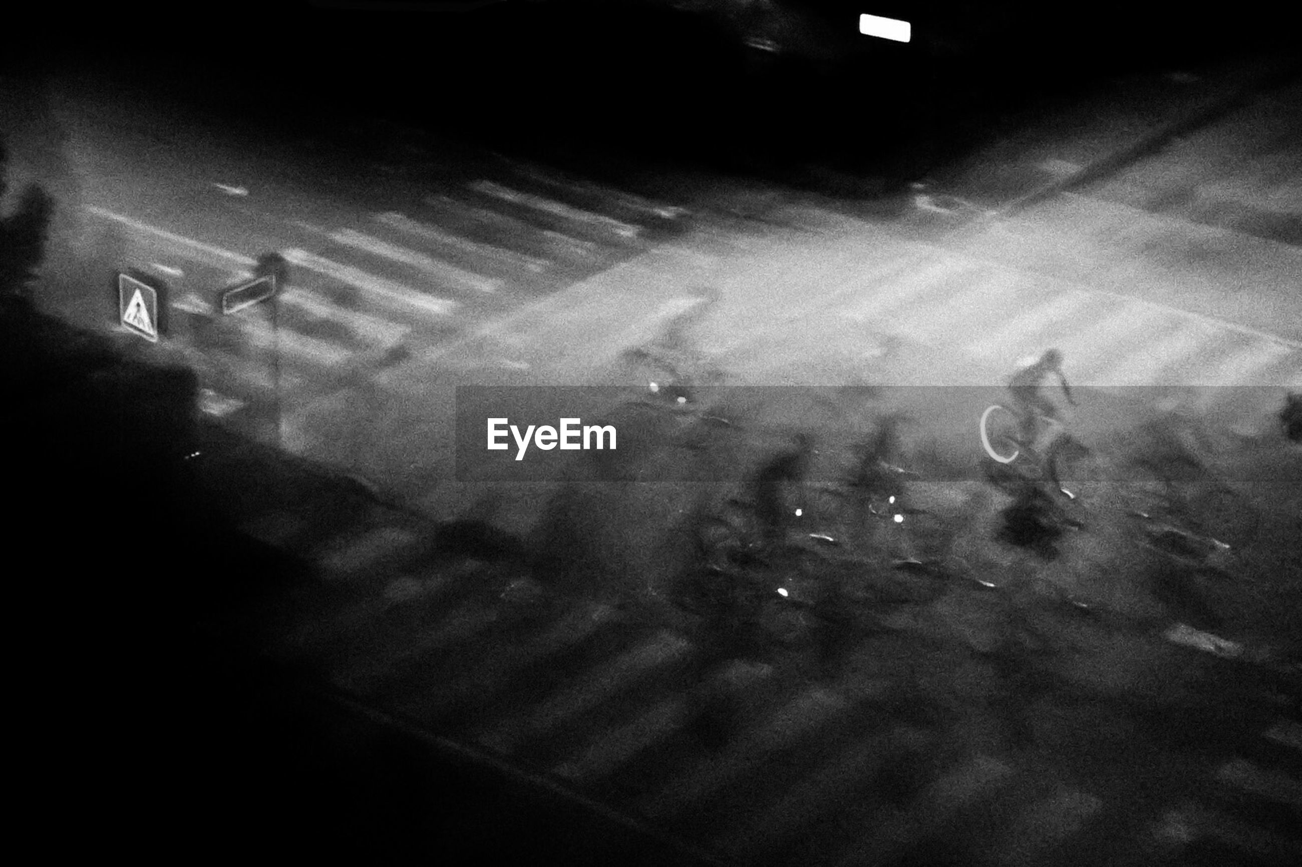 Multiple exposure of man riding bicycle on street