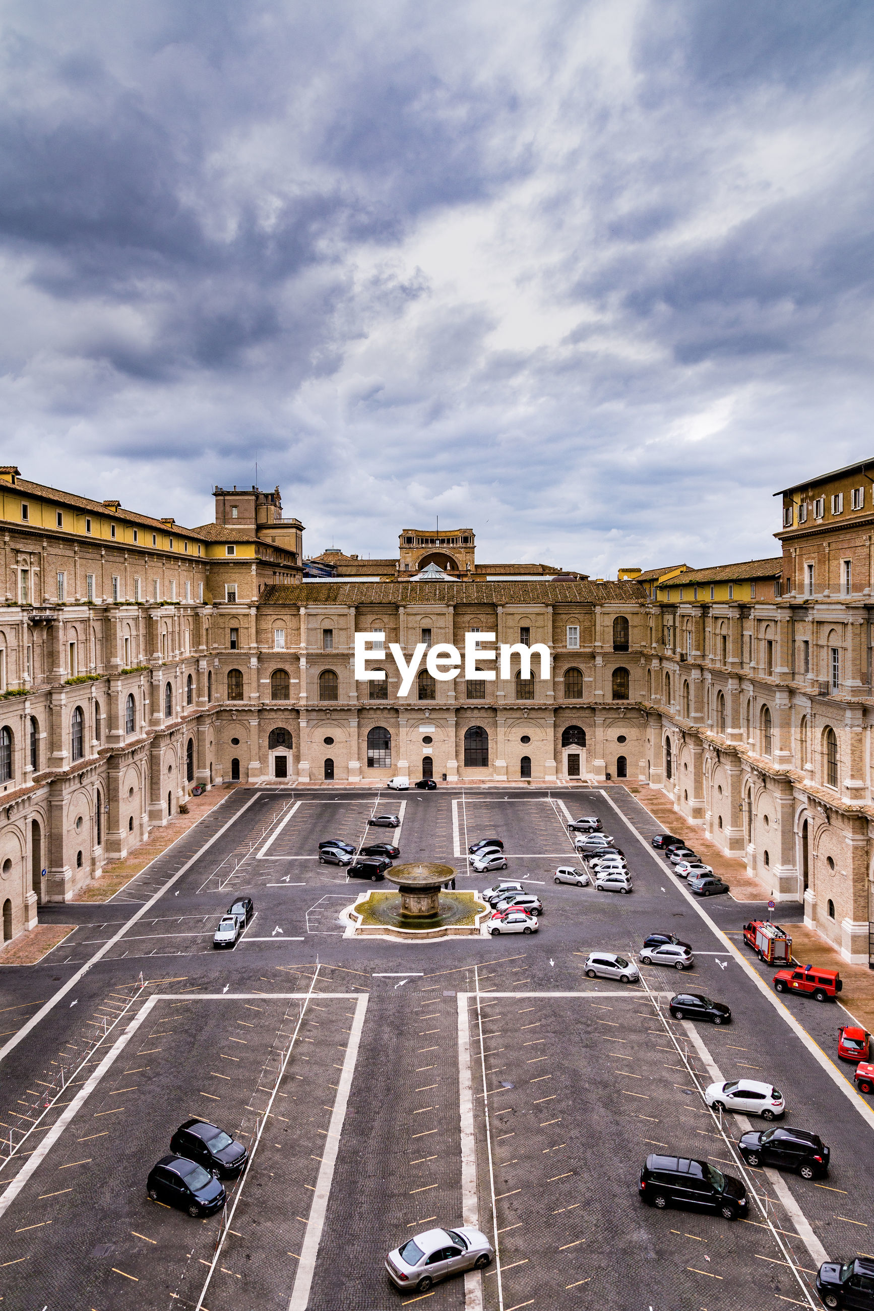 High angle view of cars parked at cortile del belvedere in city