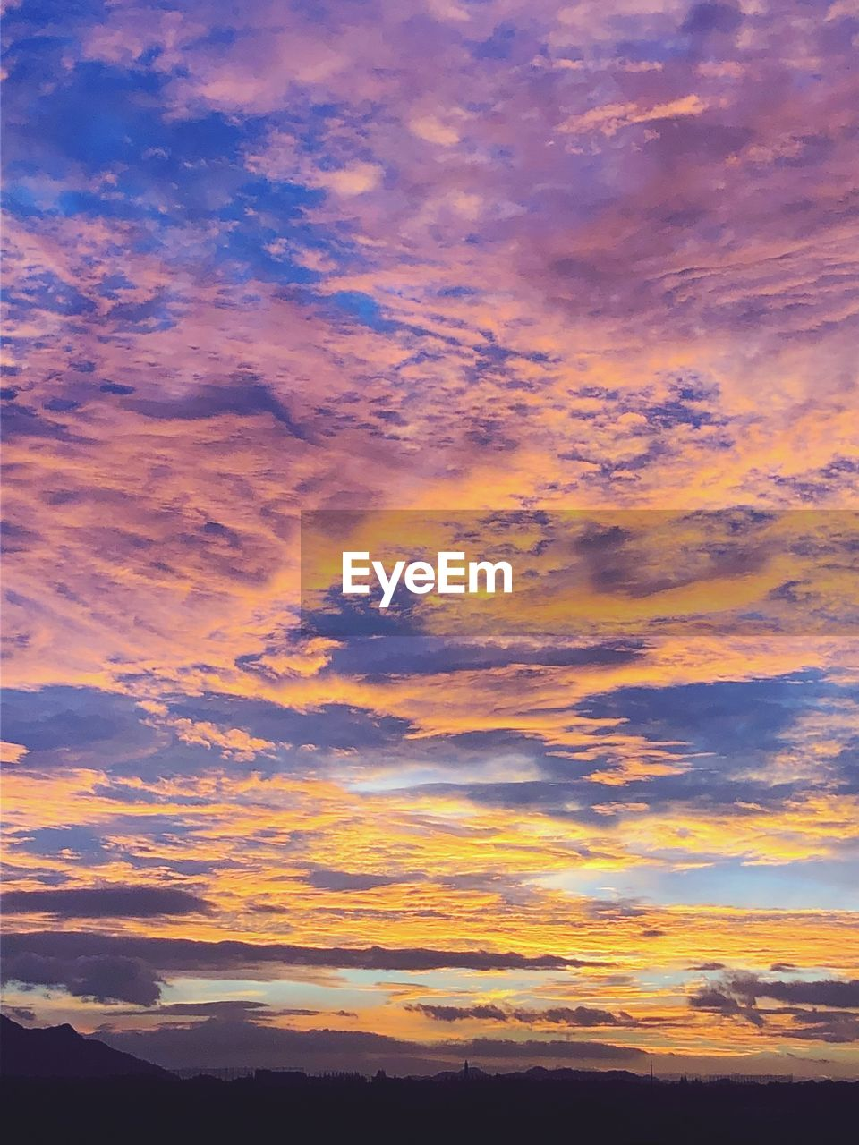 cloud - sky, sky, sunset, beauty in nature, scenics - nature, tranquility, orange color, tranquil scene, no people, dramatic sky, idyllic, nature, low angle view, outdoors, backgrounds, silhouette, cloudscape, awe, atmospheric mood, romantic sky, meteorology