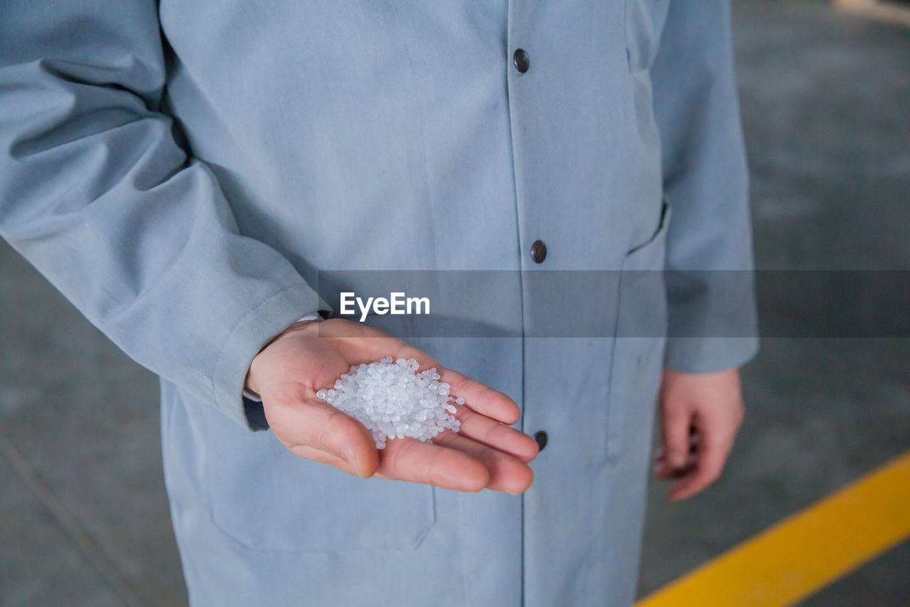 Close-Up Of Hand Holding White Polystyrene Balls