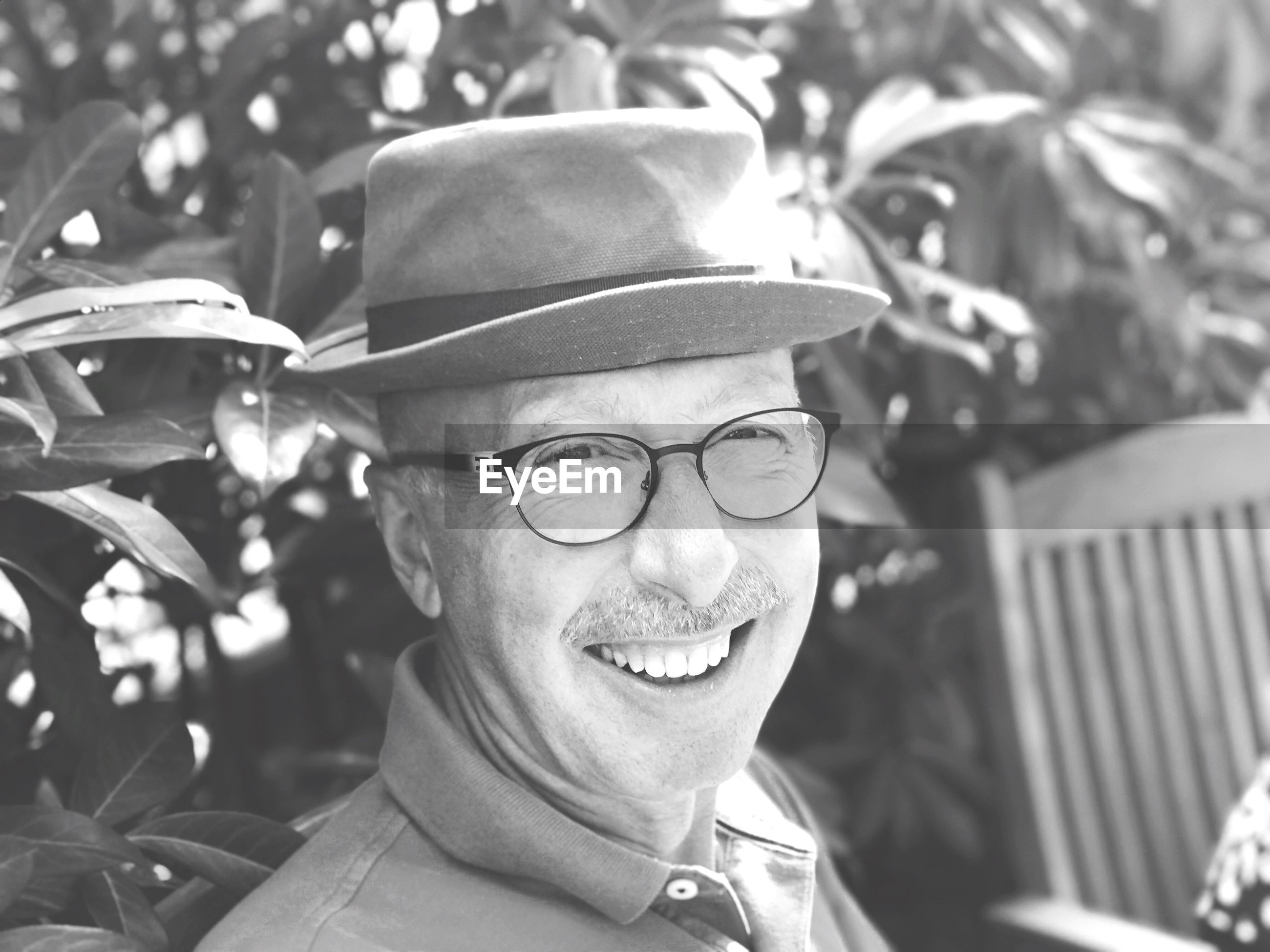 portrait, glasses, headshot, eyeglasses, real people, smiling, one person, men, hat, lifestyles, happiness, leisure activity, emotion, males, adult, focus on foreground, looking at camera, clothing, mature men, outdoors, human face