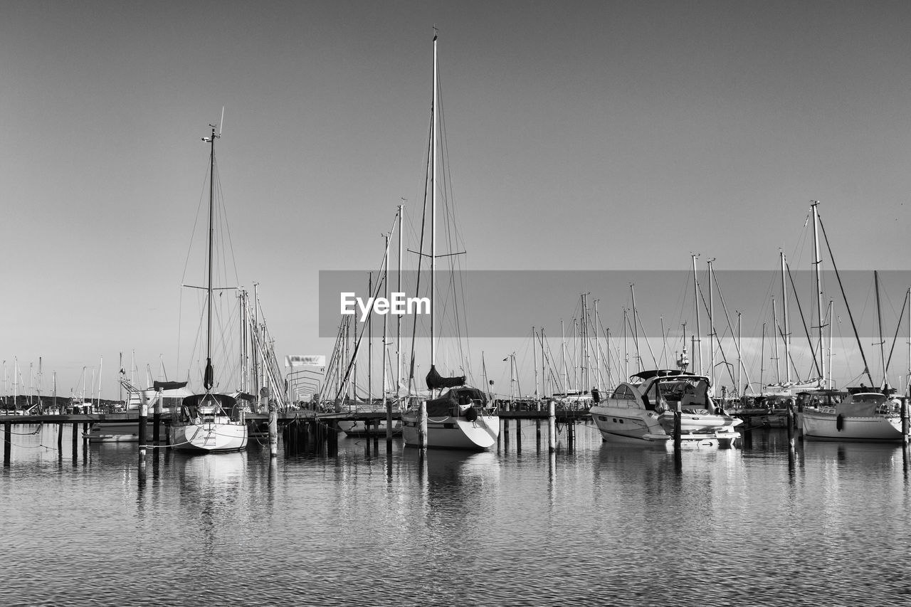 nautical vessel, transportation, water, sailboat, mode of transportation, pole, mast, sky, sea, moored, harbor, no people, waterfront, nature, day, yacht, clear sky, travel, marina, port