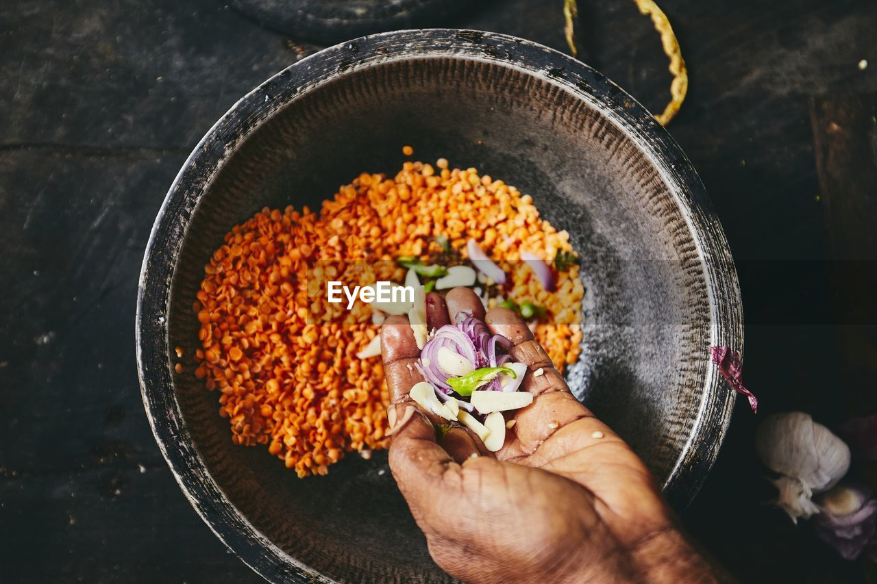human hand, hand, one person, food and drink, human body part, food, freshness, holding, real people, high angle view, flower, indoors, flowering plant, vegetable, bowl, directly above, unrecognizable person, plant, close-up, finger