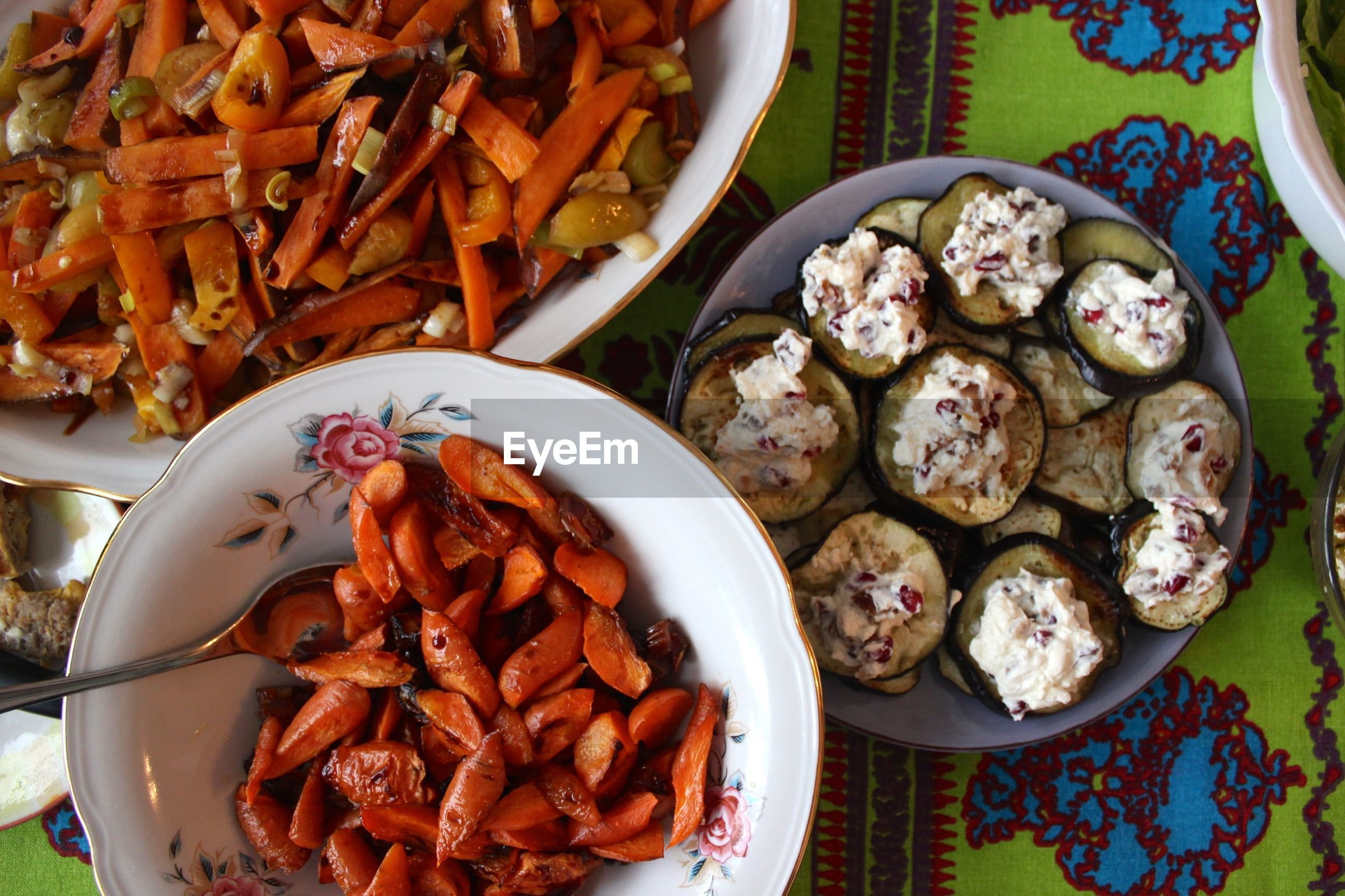 Directly above shot of eggplant with carrots served on table