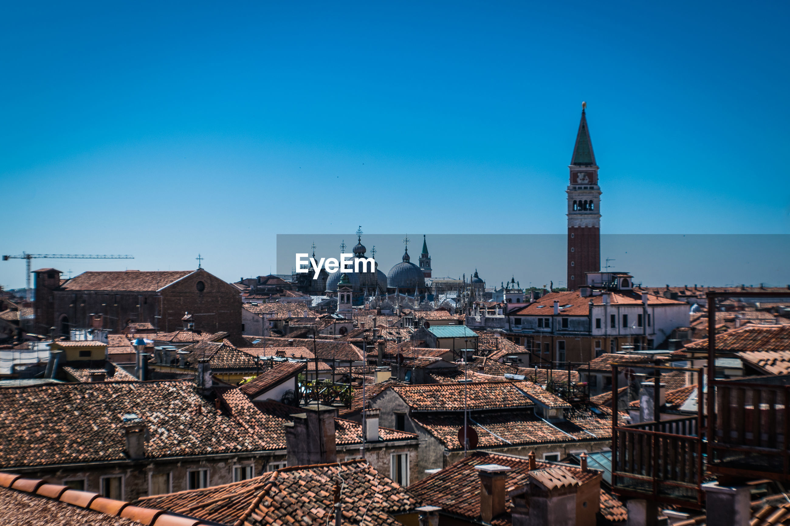 View of buildings in city of venice against blue sky