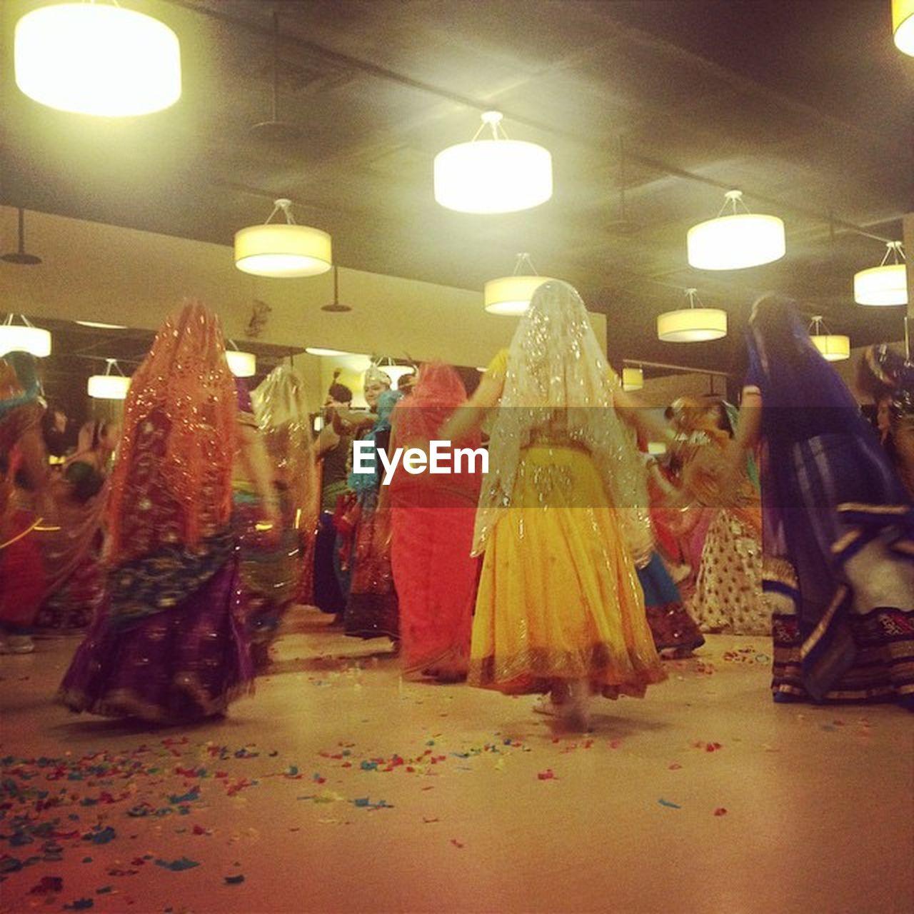 illuminated, indoors, celebration, men, retail, night, real people, large group of people, bride, women, wedding dress, people