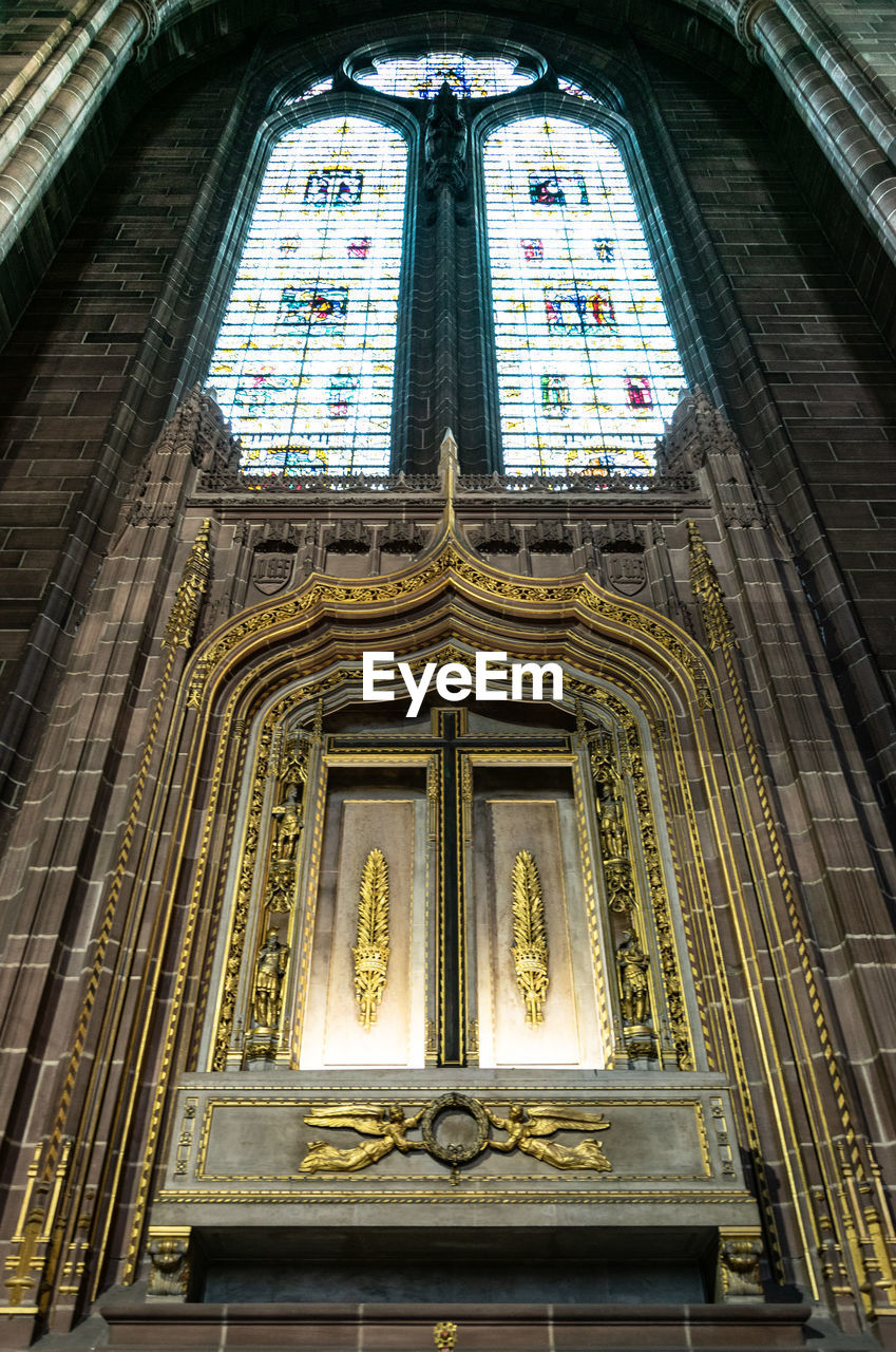 belief, architecture, built structure, spirituality, religion, low angle view, place of worship, building exterior, building, no people, travel destinations, glass - material, glass, stained glass, history, ornate
