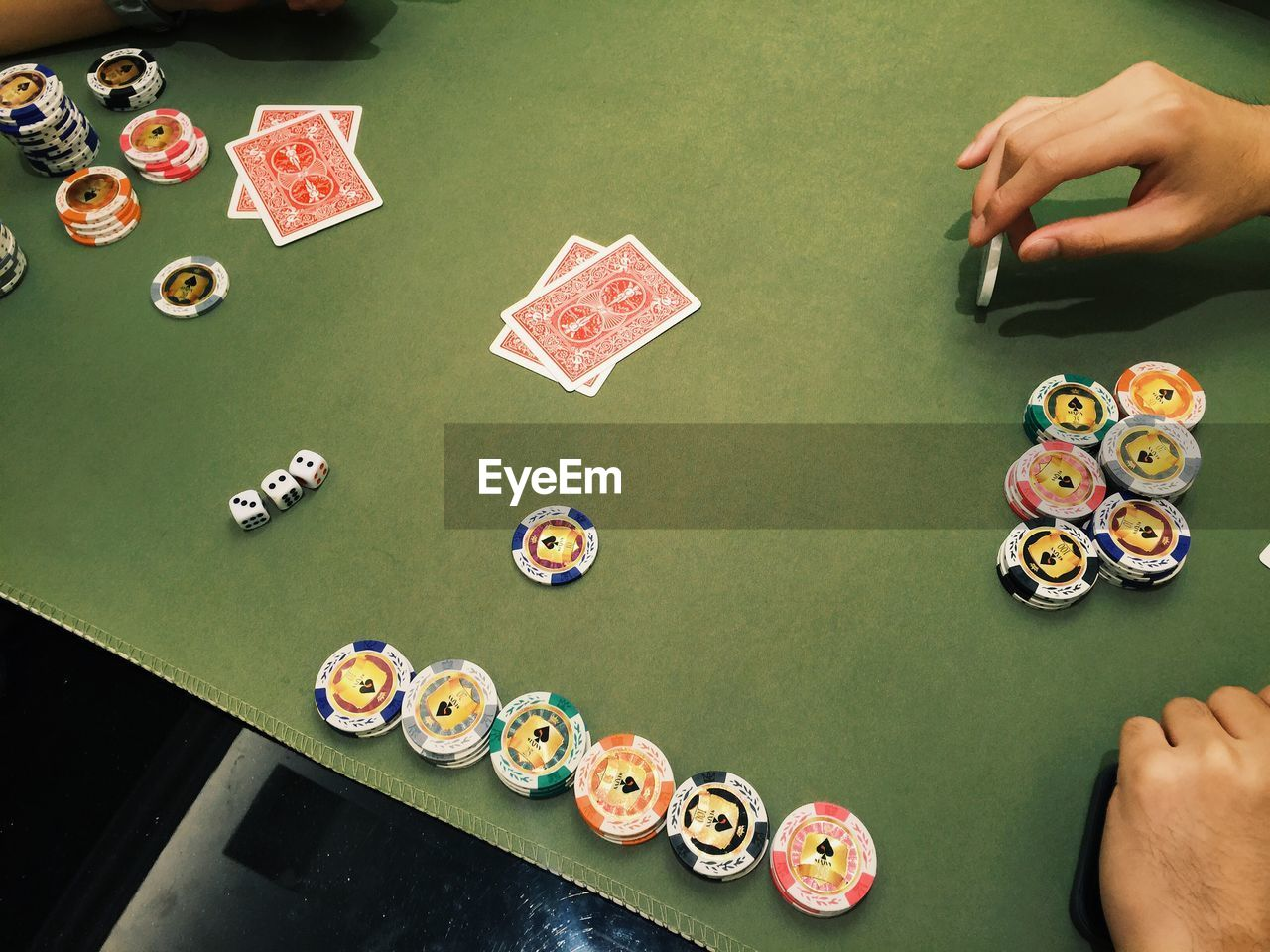 Man At Table Playing Poker