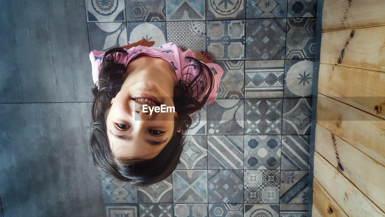 Directly Above Shot Of Happy Girl Standing On Floor