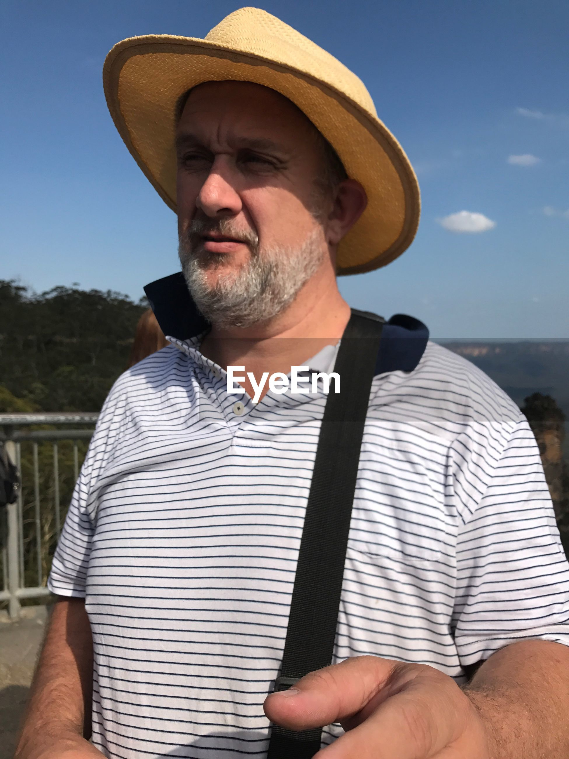 Mature man wearing hat while standing against sky