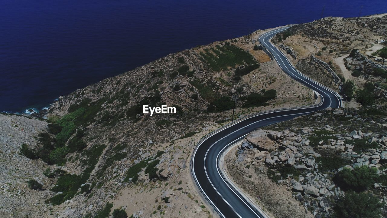 road, high angle view, transportation, landscape, winding road, curve, nature, beauty in nature, mountain, no people, day, mountain road, outdoors, scenics, aerial view, sky