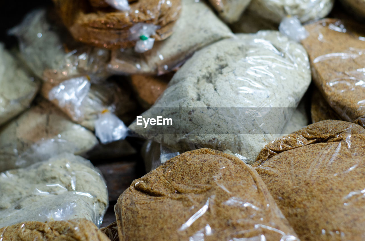 close-up, food, still life, food and drink, full frame, indoors, no people, large group of objects, freshness, selective focus, backgrounds, choice, bread, focus on foreground, retail, wellbeing, variation, store, textured, baked