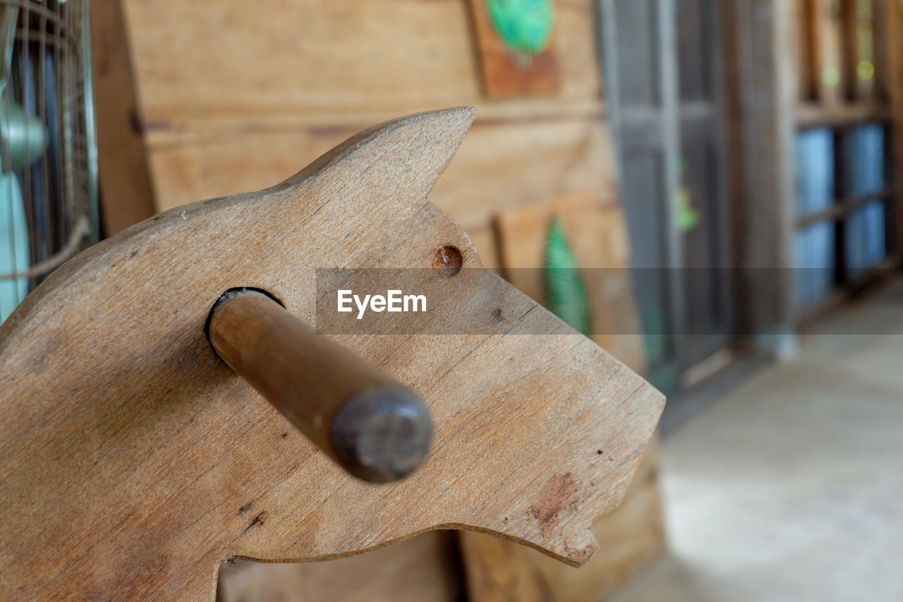 wood - material, close-up, no people, focus on foreground, day, metal, brown, work tool, indoors, still life, tool, selective focus, hand tool, equipment, rusty, nature, animal themes, textured, built structure, hand saw