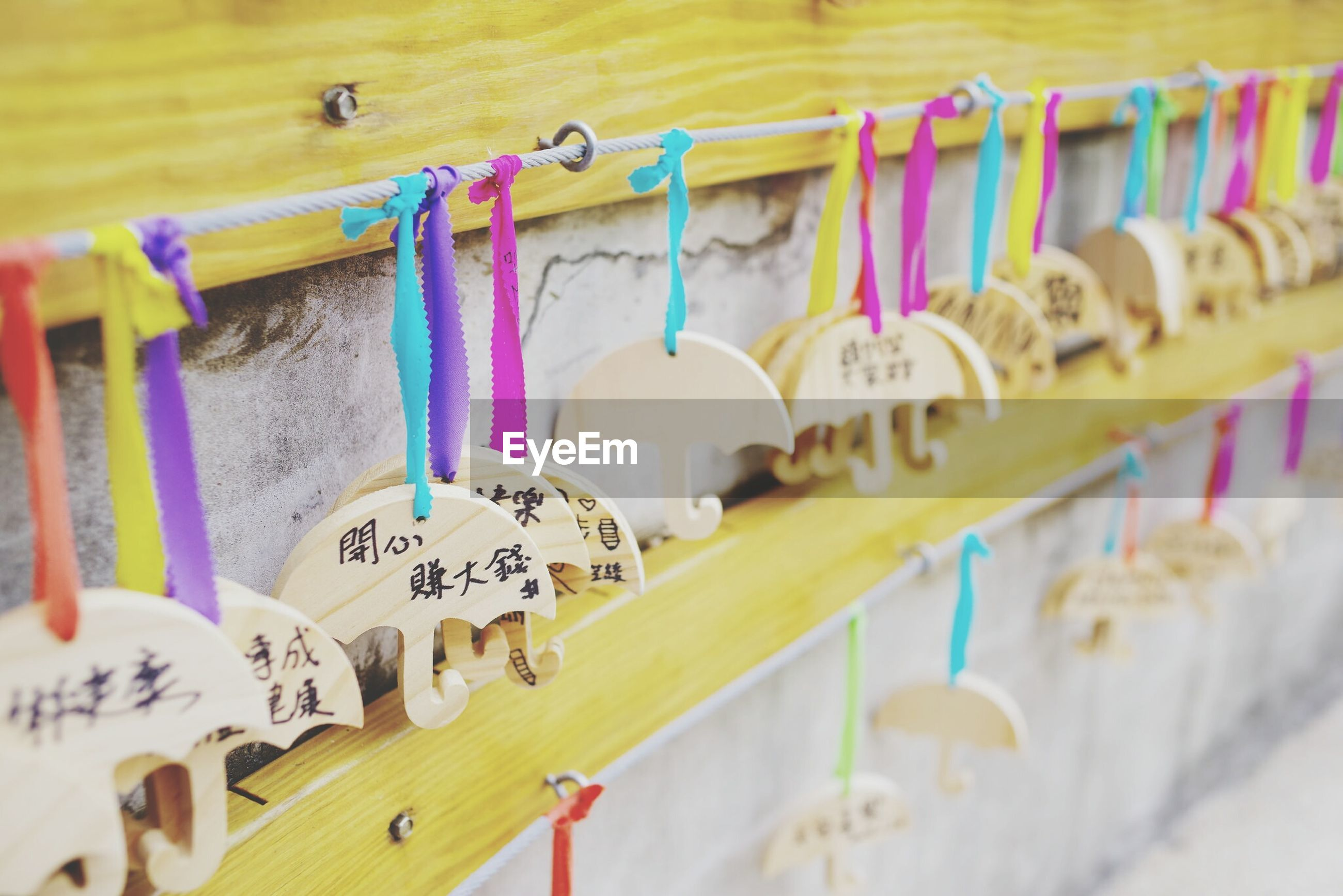 hanging, variation, multi colored, large group of objects, coathanger, clothes rack, no people, choice, day, indoors, close-up, clip