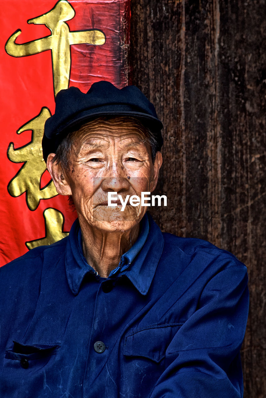 senior adult, portrait, one person, looking at camera, adult, wrinkled, real people, men, clothing, lifestyles, front view, males, senior men, headshot, hat, human face, human body part, contemplation, social issues