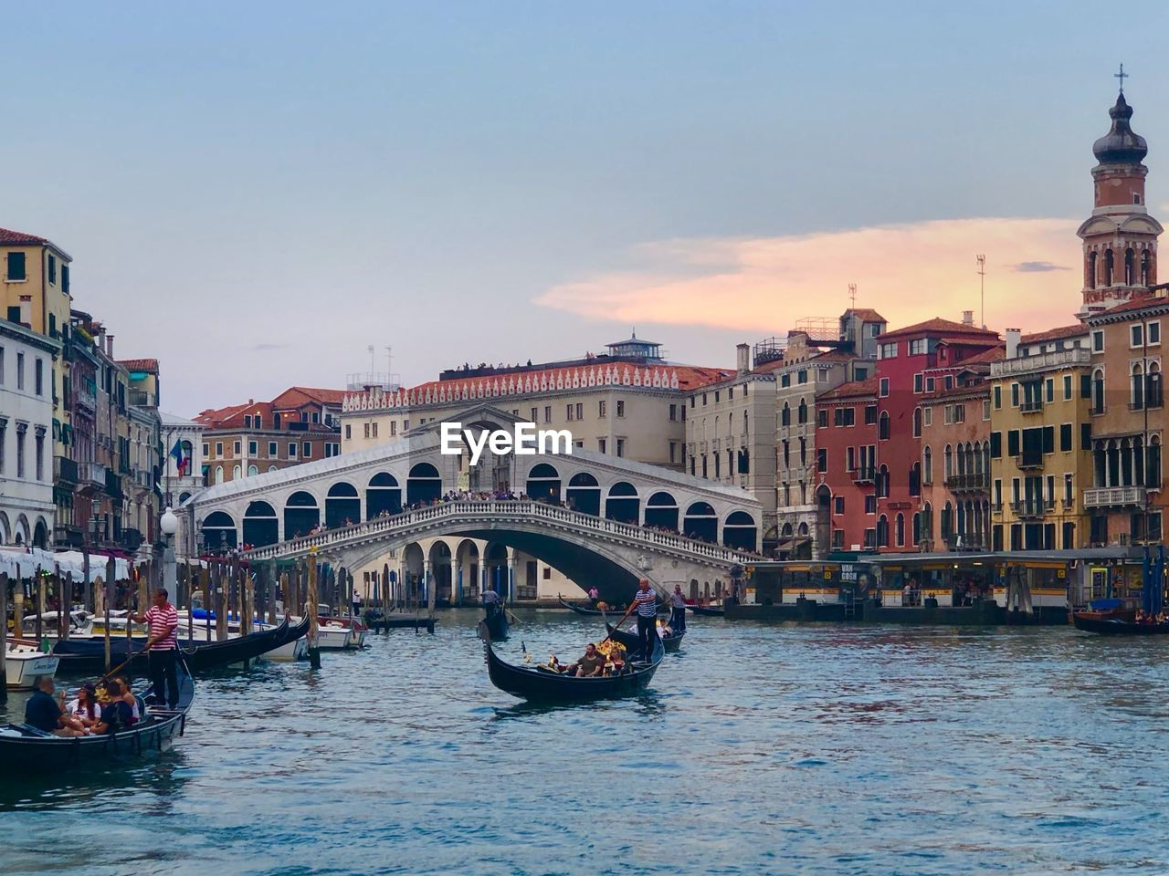 built structure, water, nautical vessel, architecture, building exterior, sky, transportation, canal, waterfront, mode of transportation, travel, city, travel destinations, nature, real people, tourism, building, group of people, gondola - traditional boat, outdoors, bridge - man made structure, passenger craft, wooden post