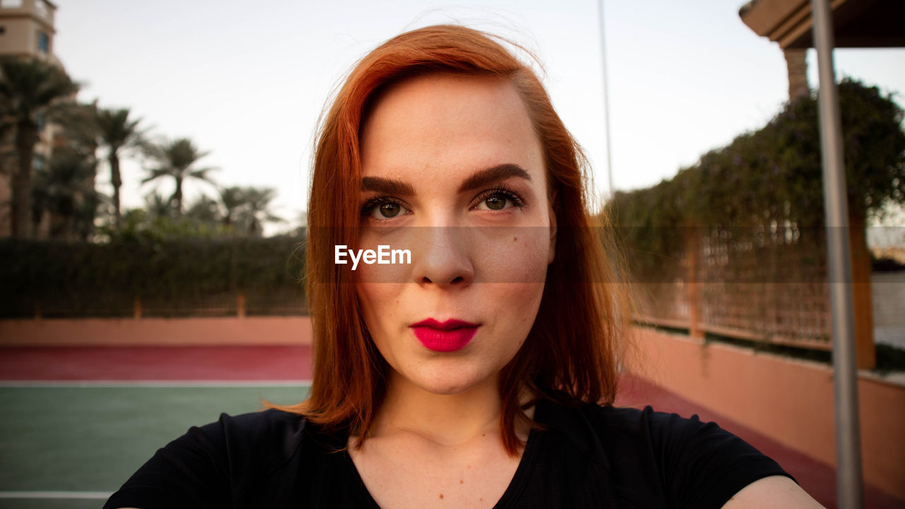 Portrait Of Woman Wearing Red Lipstick