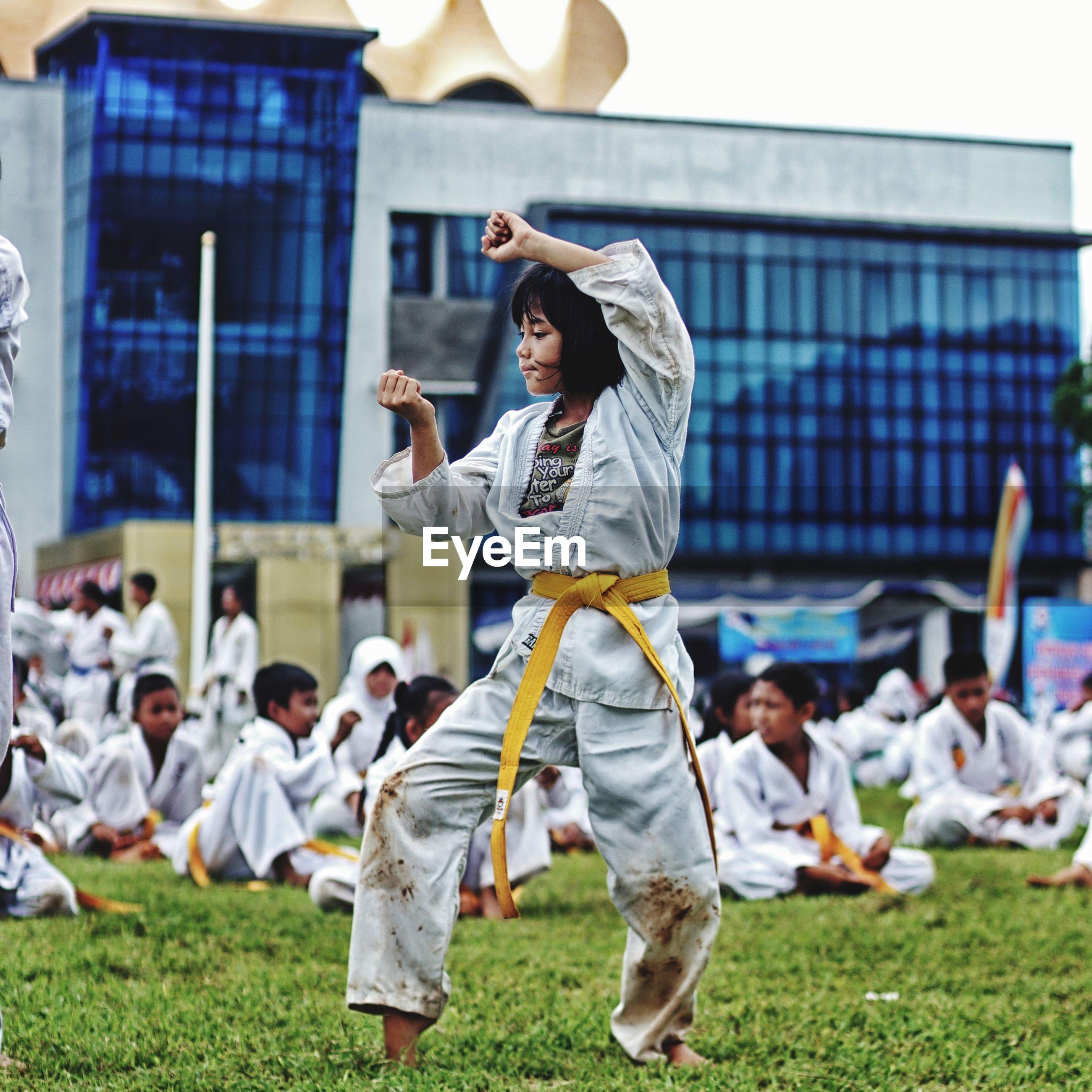 Girl practicing karate on field