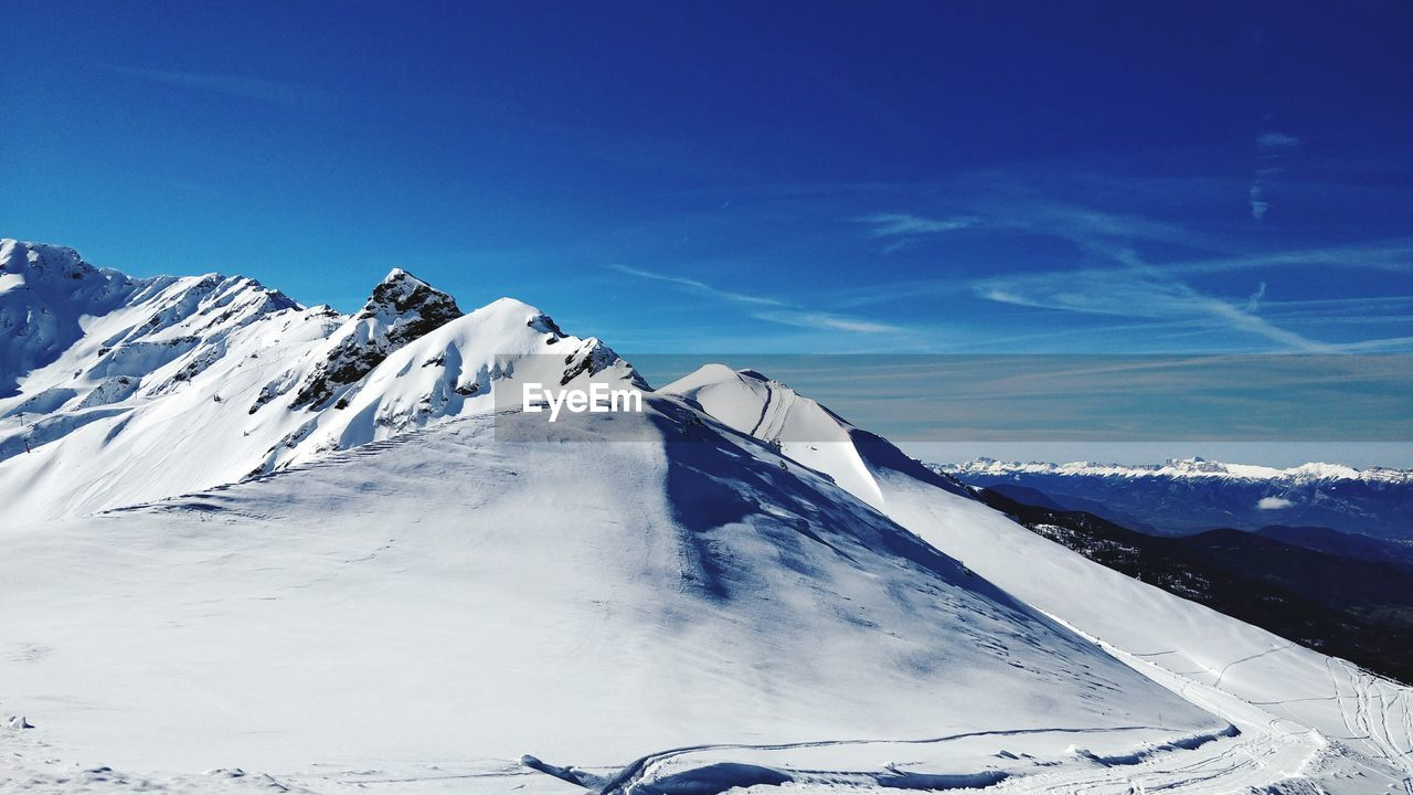 winter, snow, cold temperature, mountain, scenics - nature, sky, beauty in nature, snowcapped mountain, mountain range, tranquil scene, environment, tranquility, landscape, nature, non-urban scene, blue, white color, cloud - sky, day, no people, mountain peak