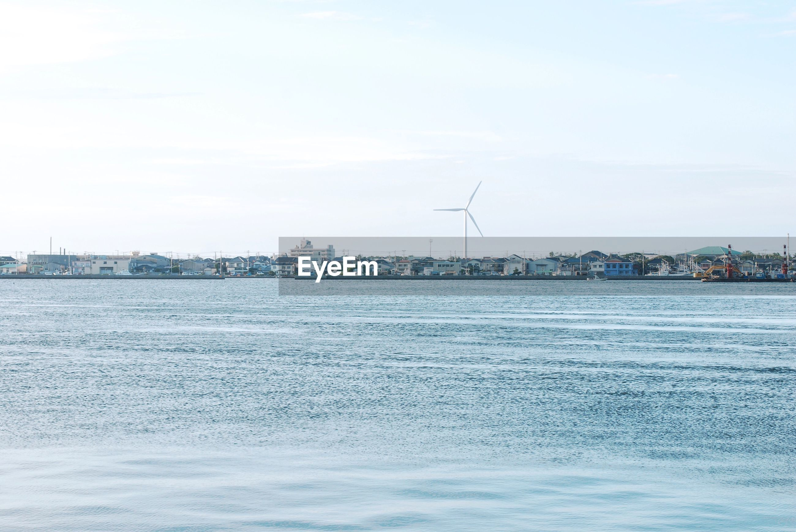 water, sea, waterfront, sky, day, outdoors, no people, alternative energy, nature, built structure, nautical vessel, architecture, wind power, building exterior, wind turbine, windmill, beauty in nature, city