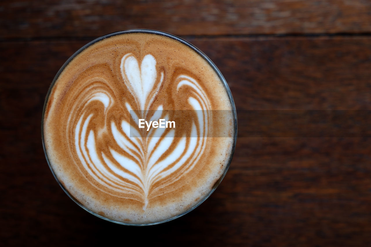 coffee - drink, coffee, frothy drink, food and drink, still life, cappuccino, coffee cup, froth art, drink, refreshment, mug, cup, hot drink, creativity, table, close-up, freshness, latte, indoors, directly above, no people, crockery, non-alcoholic beverage