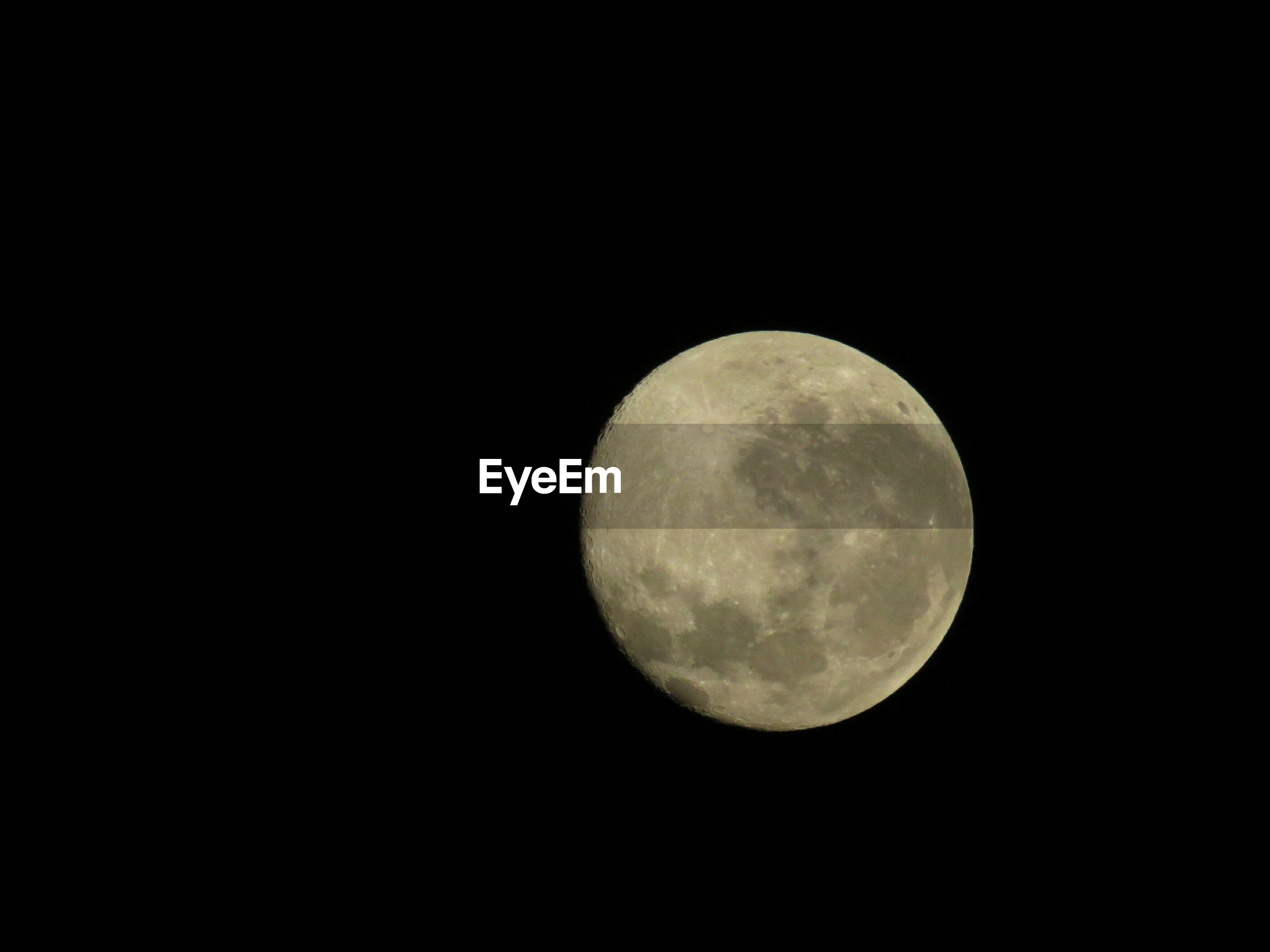 moon, astronomy, night, full moon, planetary moon, moon surface, circle, space exploration, copy space, discovery, beauty in nature, low angle view, sphere, dark, tranquil scene, scenics, tranquility, nature, sky, majestic