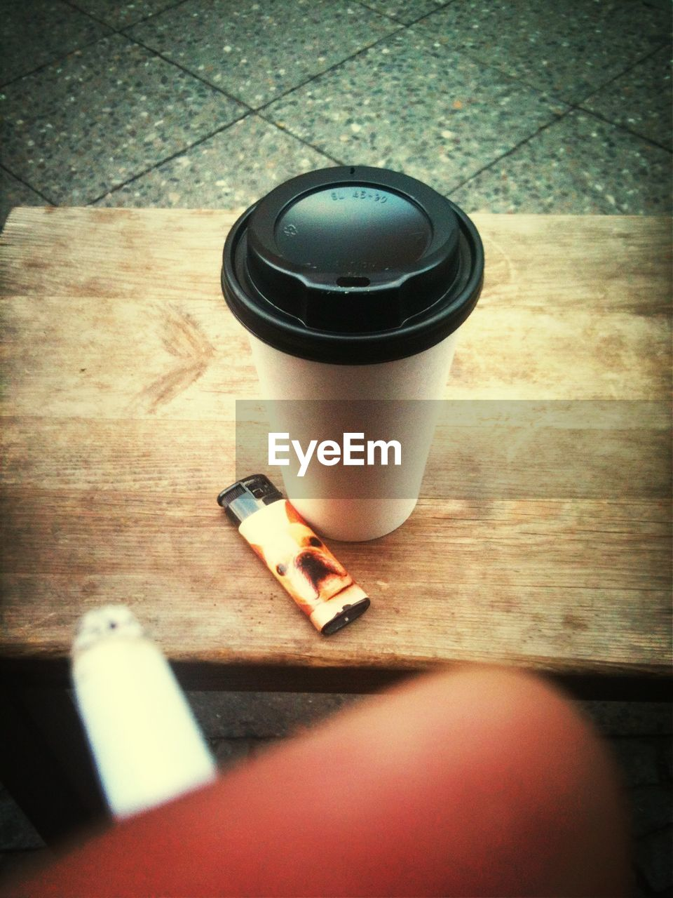 table, indoors, bad habit, high angle view, addiction, ashtray, real people, one person, day, close-up