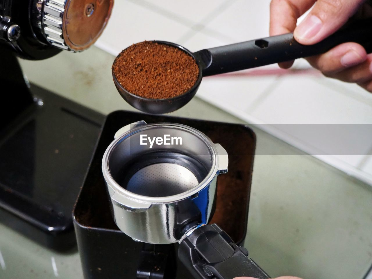 human hand, one person, preparation, hand, appliance, holding, food and drink, indoors, human body part, real people, coffee, ground coffee, coffee - drink, freshness, close-up, lifestyles, drink, focus on foreground, body part, finger, preparing food