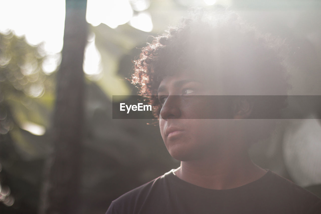 Close-Up Of Serious Young Man Looking Away
