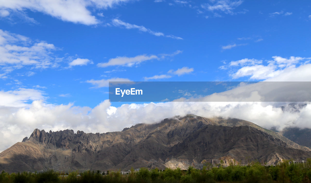mountain, nature, sky, beauty in nature, scenics, cloud - sky, day, mountain range, landscape, outdoors, tranquility, tranquil scene, no people, blue