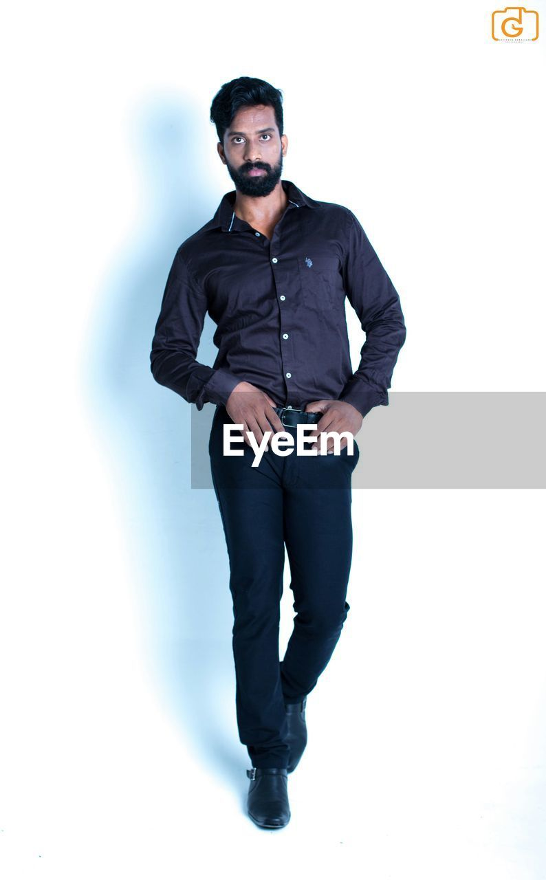 full length, one person, sunglasses, studio shot, standing, front view, real people, white background, young adult, attitude, looking at camera, portrait, lifestyles, one man only, day, people
