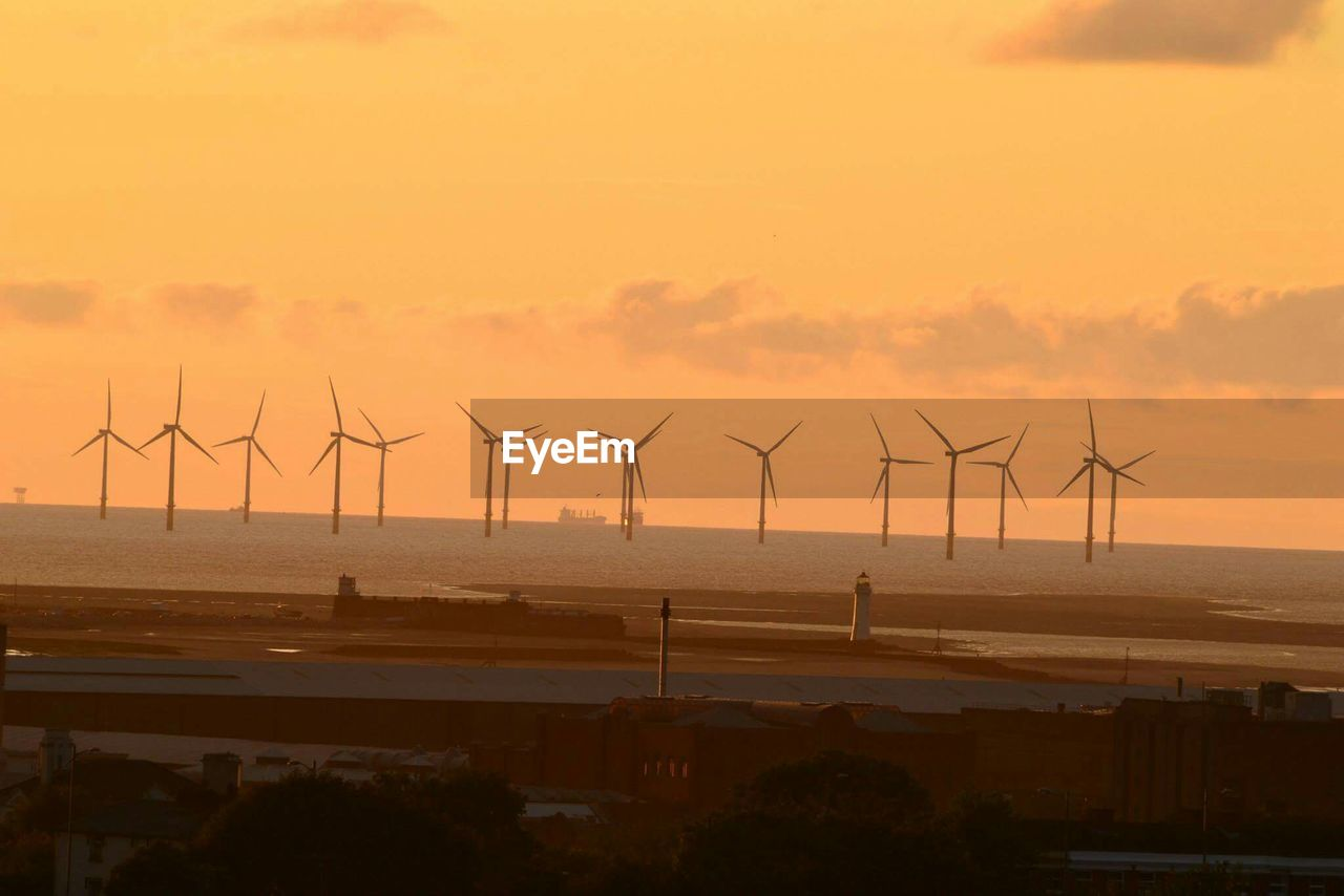 environmental conservation, wind turbine, alternative energy, wind power, fuel and power generation, renewable energy, sunset, no people, windmill, outdoors, nature, sustainable resources, technology, industrial windmill, sky, power in nature, day