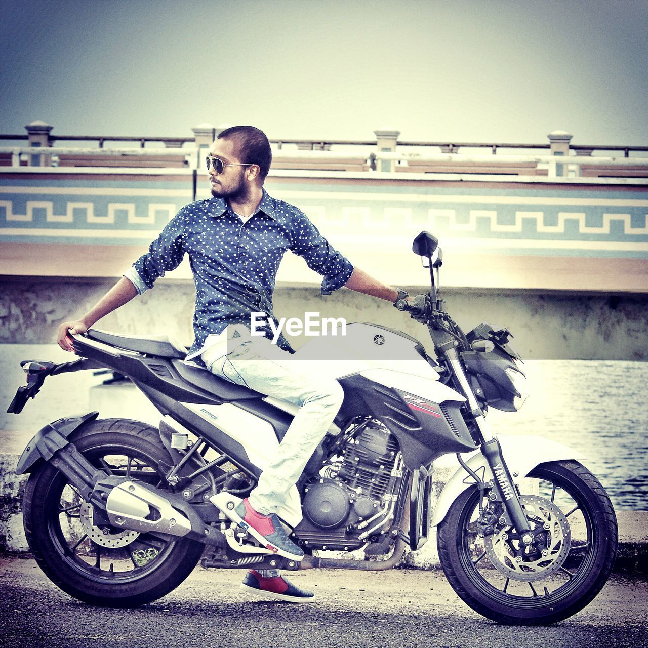 Full length of man sitting on motorcycle