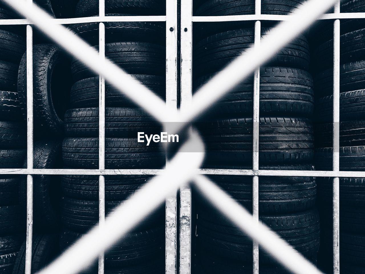 Tires behind grid