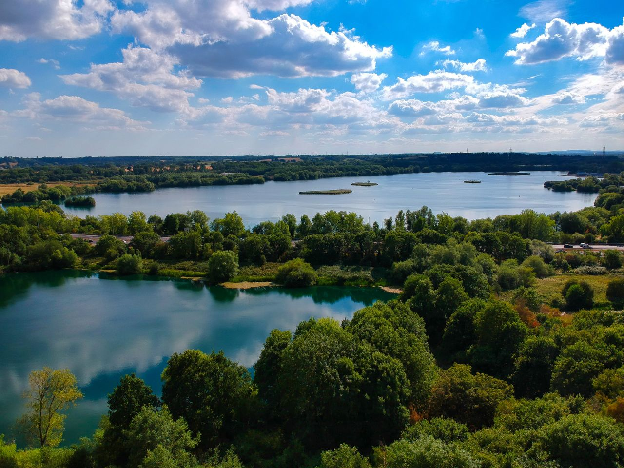 water, sky, cloud - sky, scenics - nature, tree, plant, tranquil scene, beauty in nature, tranquility, nature, no people, day, green color, growth, lake, outdoors, non-urban scene, land